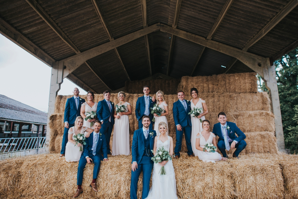 wedding party group shots in hay barn