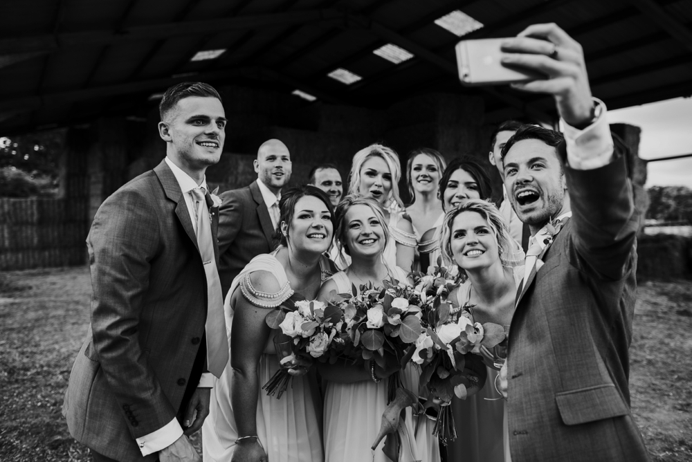 groups of friends doing a selfie at wedding
