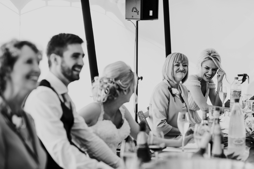 maid of honor laughing in speeches