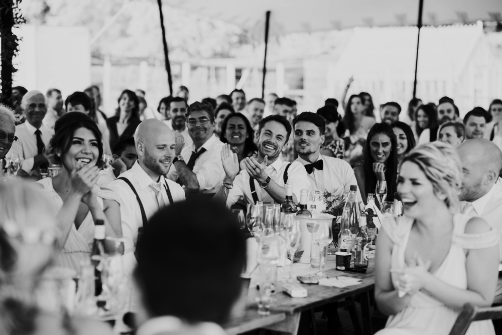 man clapping in wedding speech