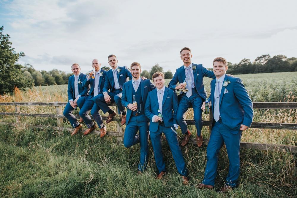 boys on fence wedding group photos