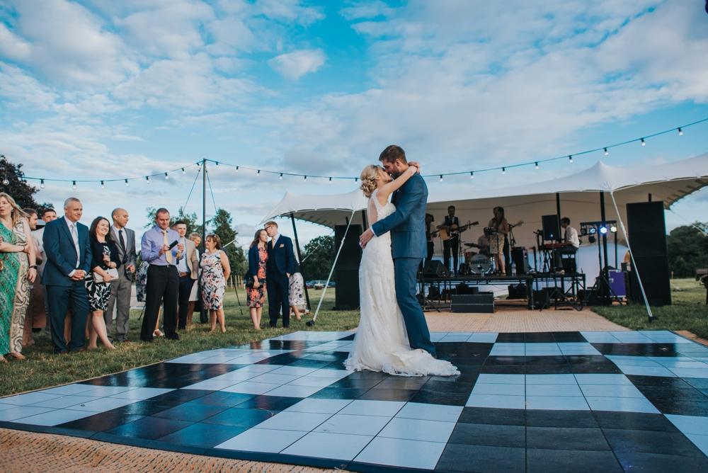 bride groom first dance on open air dance floor