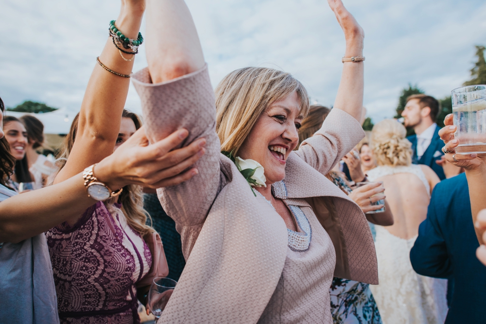 mother of the bride dancing festival wedding