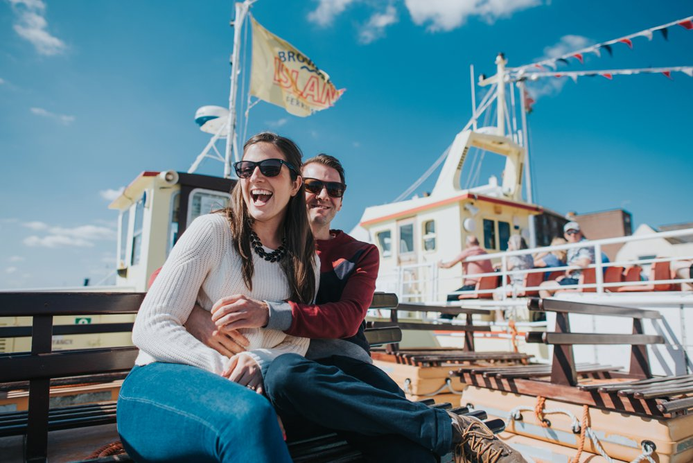 engagement photography, couple on boat, blue sky
