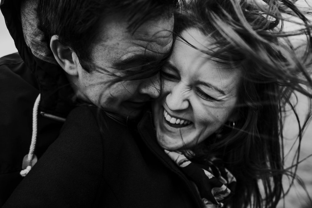 engagement photography - black and white - wind in hair