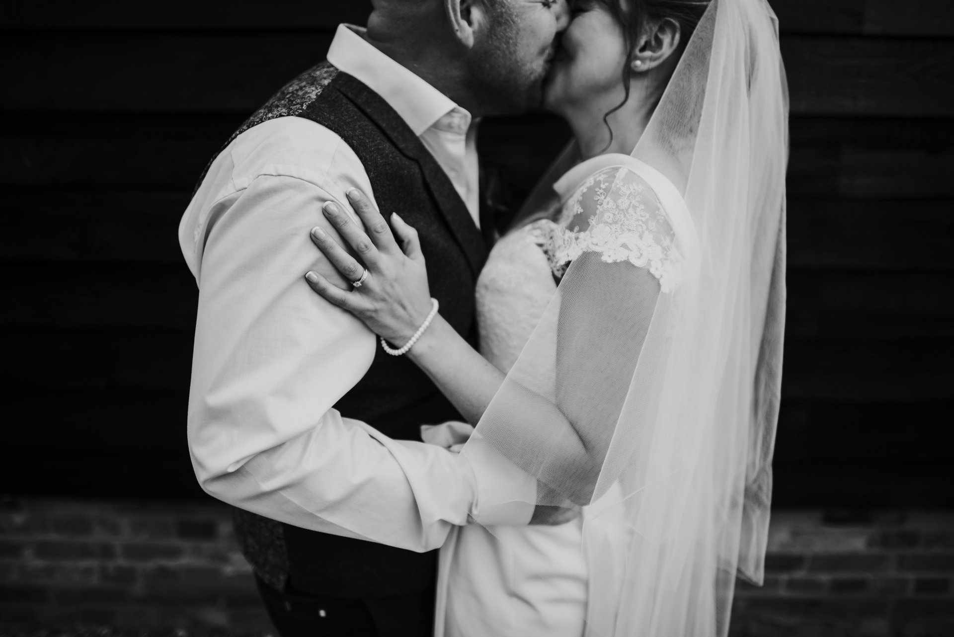 Bride and groom kissing on wedding day at The Olde Bell, Hurley