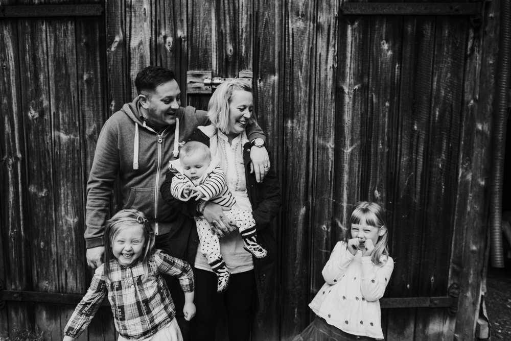 black and white photos of family laughing and cuddling