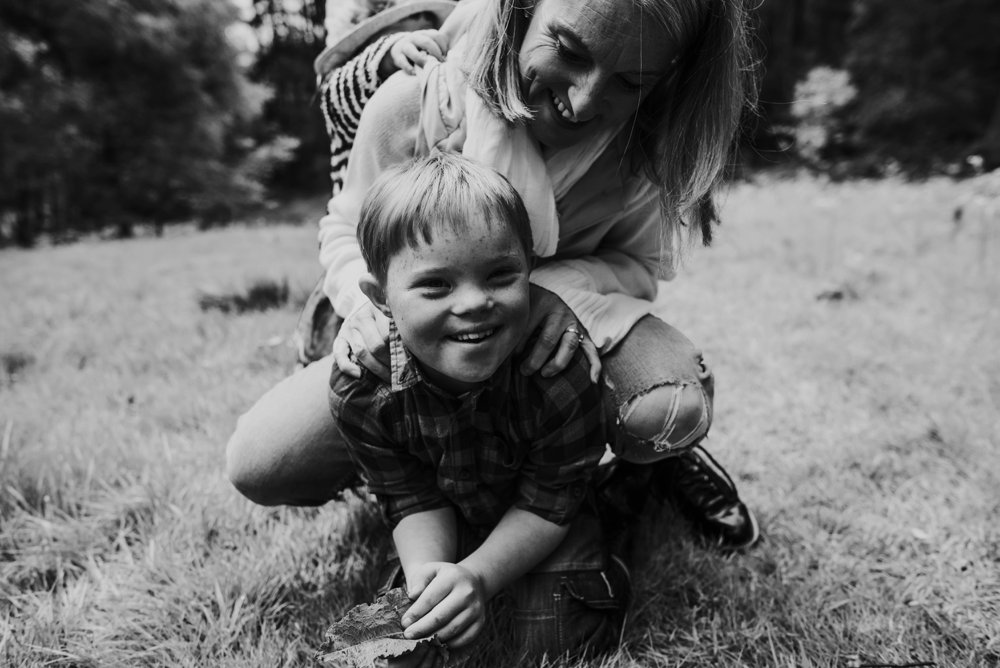 boy laughing with his mum