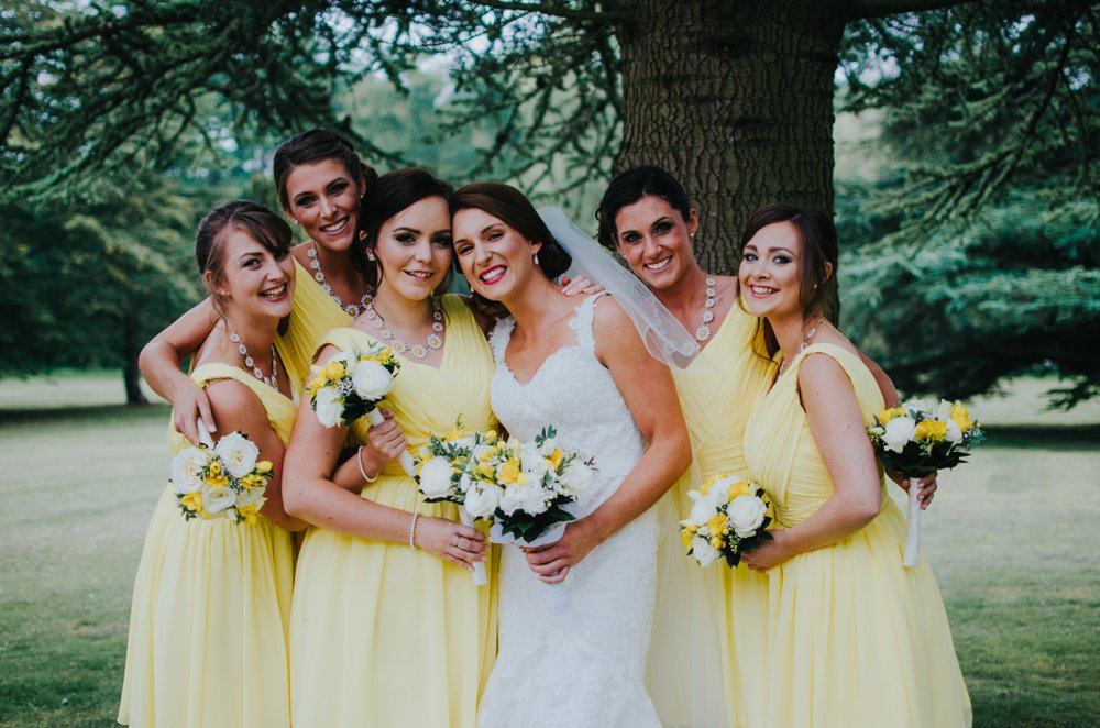 bride with bridesmaids in yellow