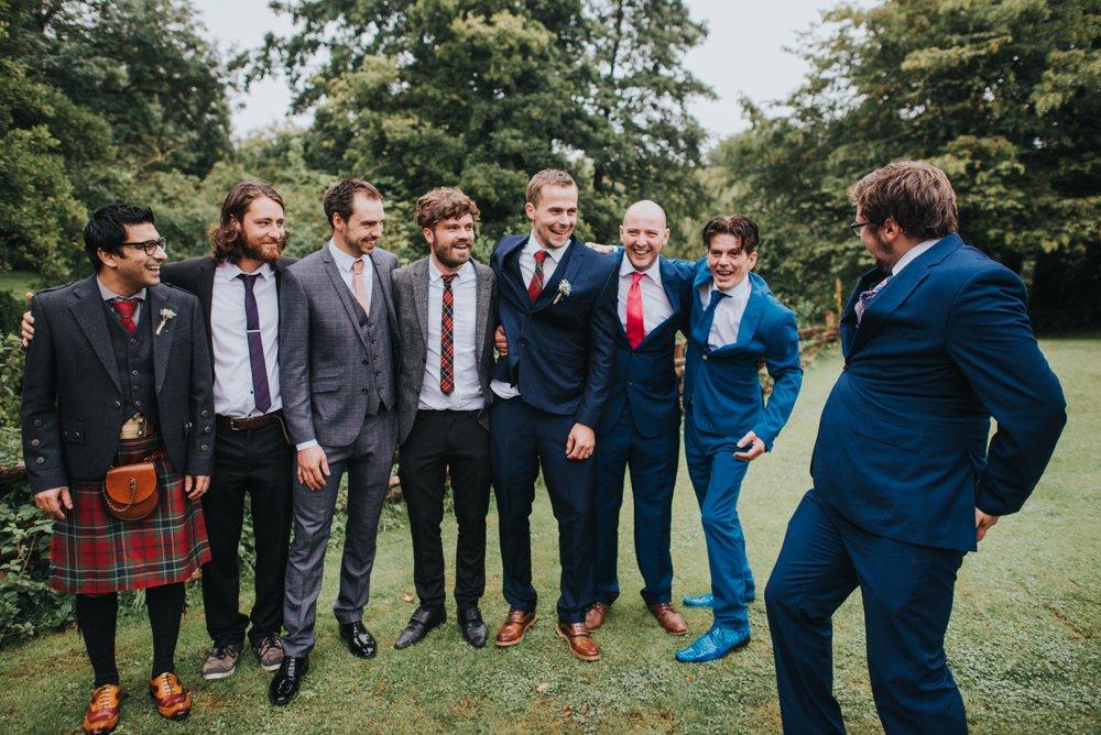 boys messing around at wedding