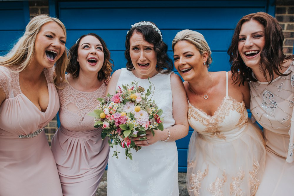 bride and bridesmaids pulling silly faces