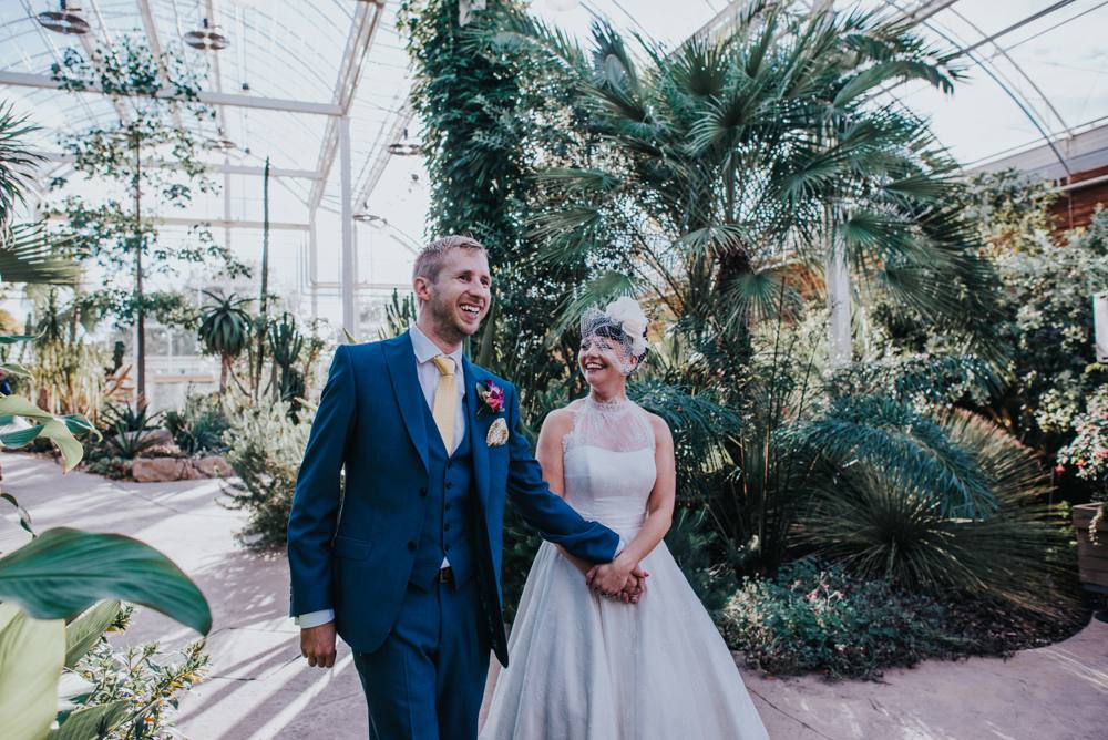 bride and grooms entrance into RHS Wisley Glasshouse