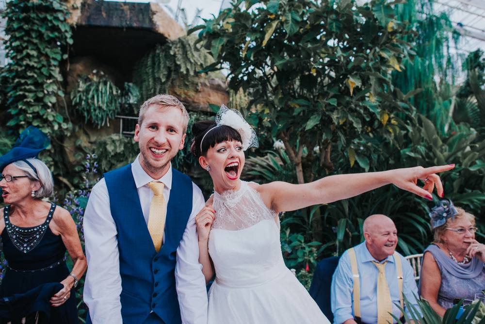 Bride and grroms reaction to photos in wedding speeches