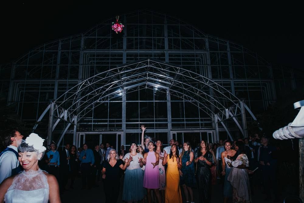 Bouquet toss, glass house