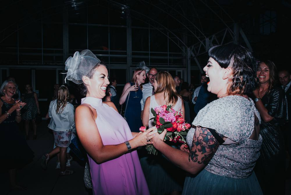 Two girls catch wedding bouquet