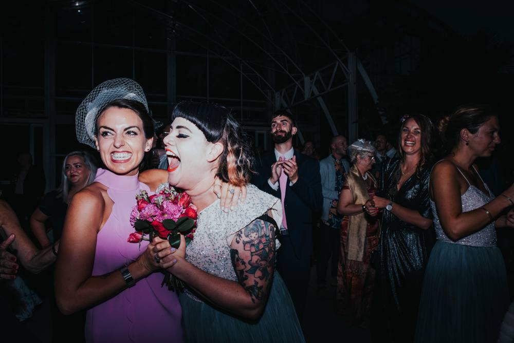 Two girls catch wedding bouquet
