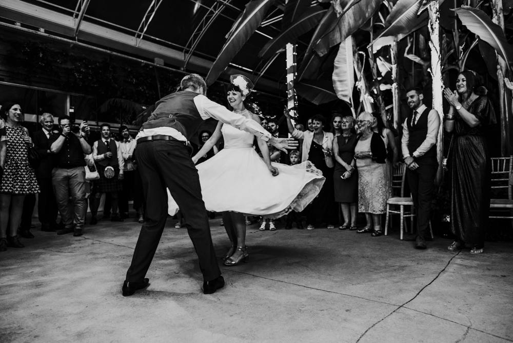 Quirky festival bride and groom, first dance