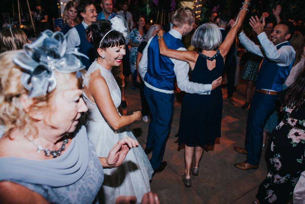 Quirky bride dancing on wedding day