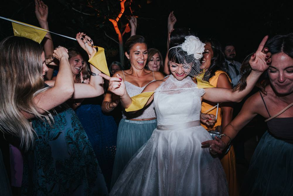 Quirky bride with birdcage dancing