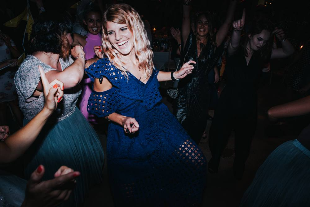 Blonde haired girl dancing at wedding