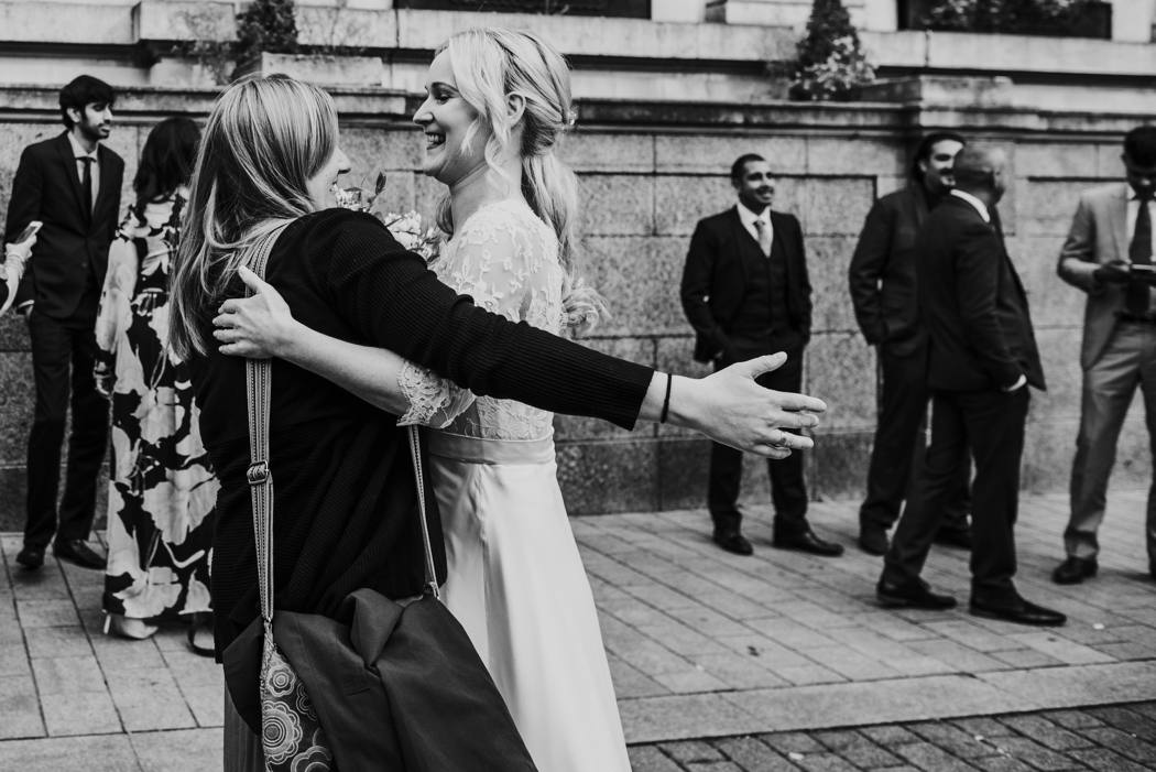 bride greeting guest at islington town hall