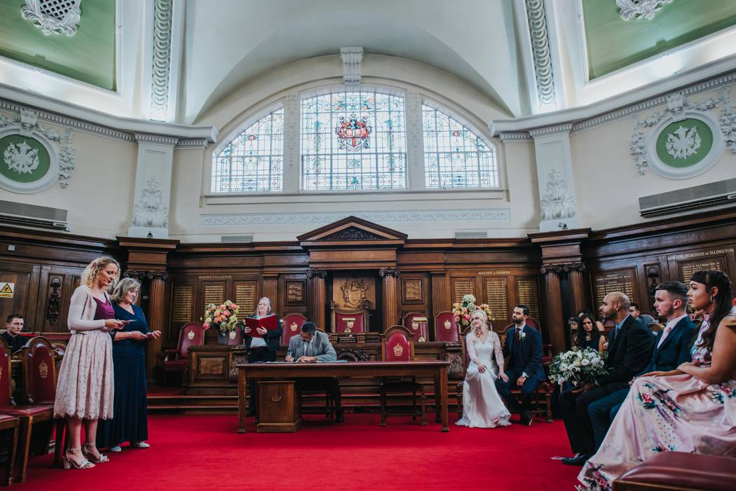bride and groom sitting in islingston town hall ceremony