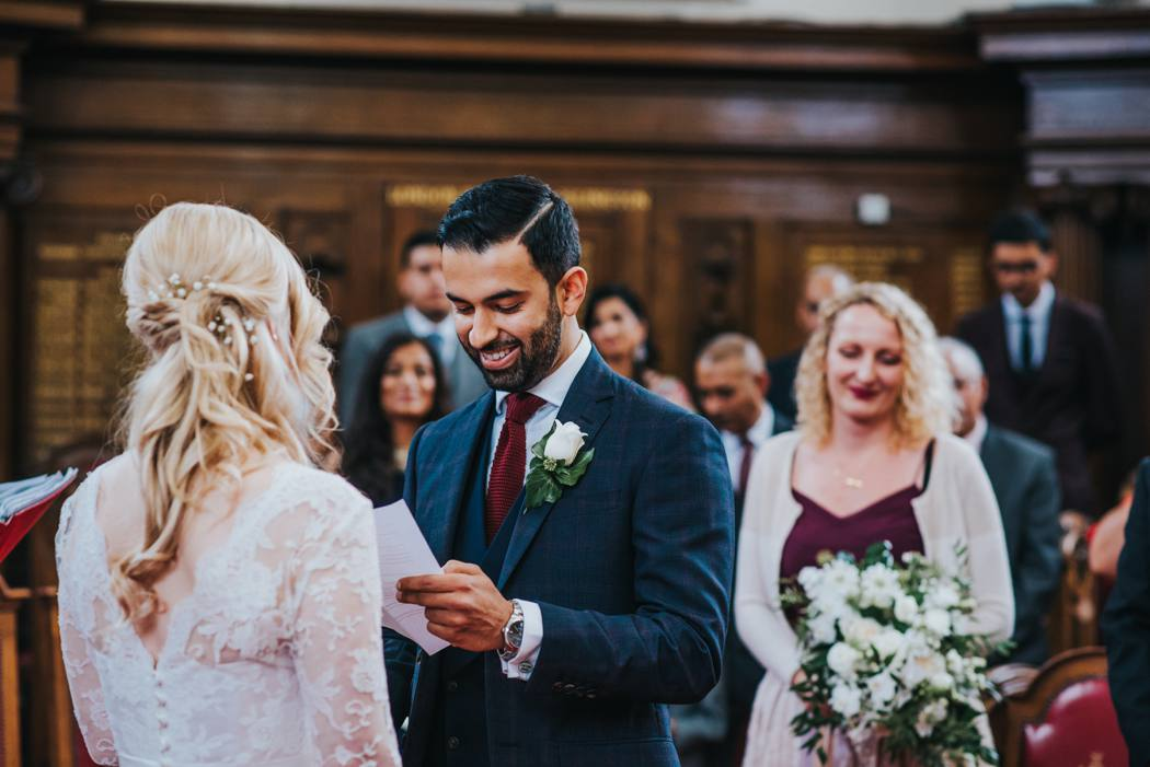 groom reading vows at islington town hall