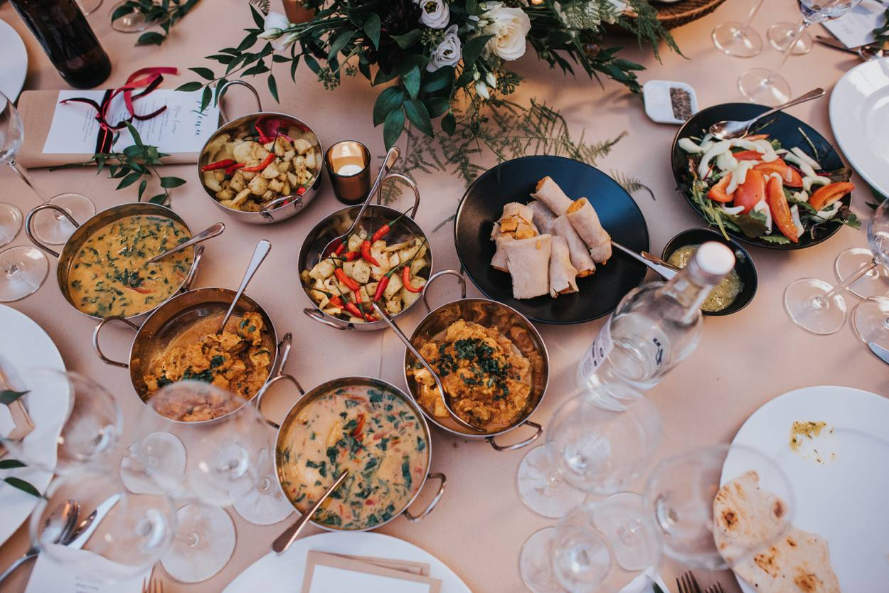 table full of curry, wedding food