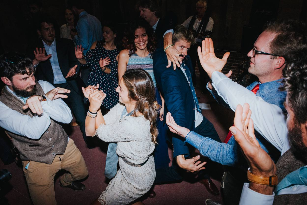 wedding guests having a dance off