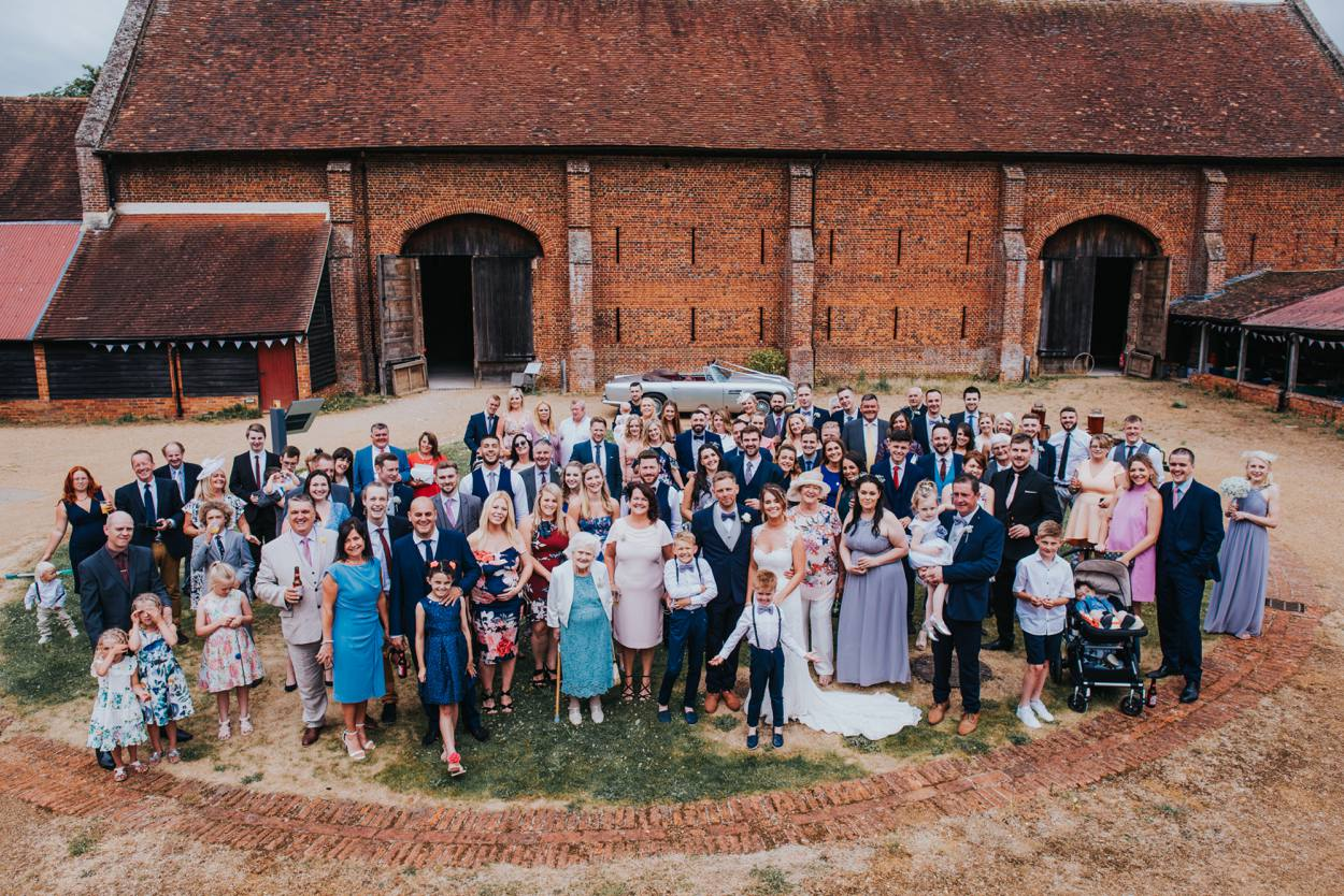 wedding group shot at old basing barn