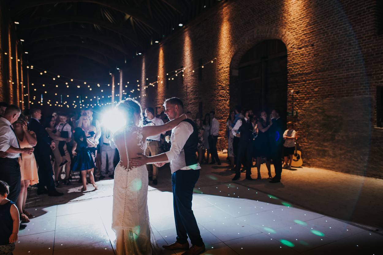 bride and groom first dance old basing barn