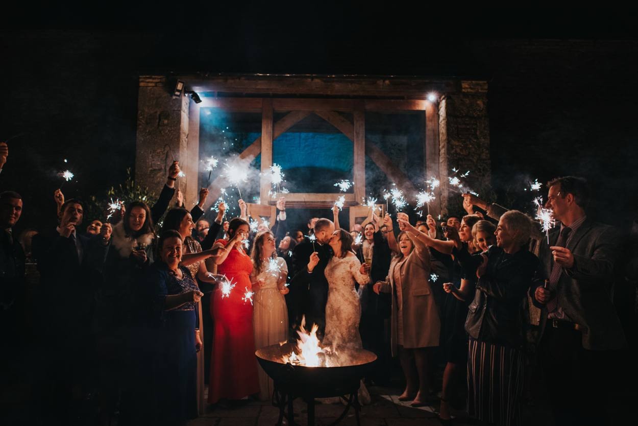 Cripps Stone Barn winter wedding with sparklers