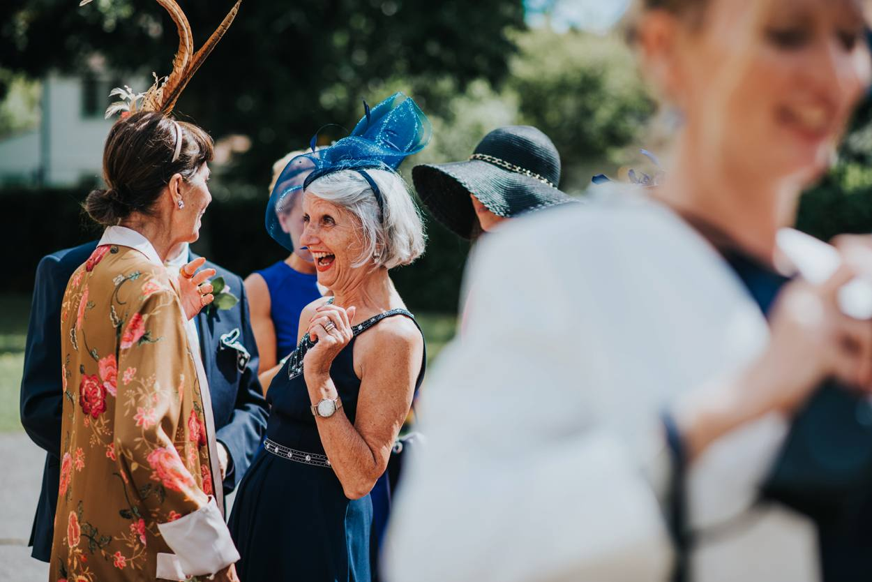mother of bride greeting a friend with a smile