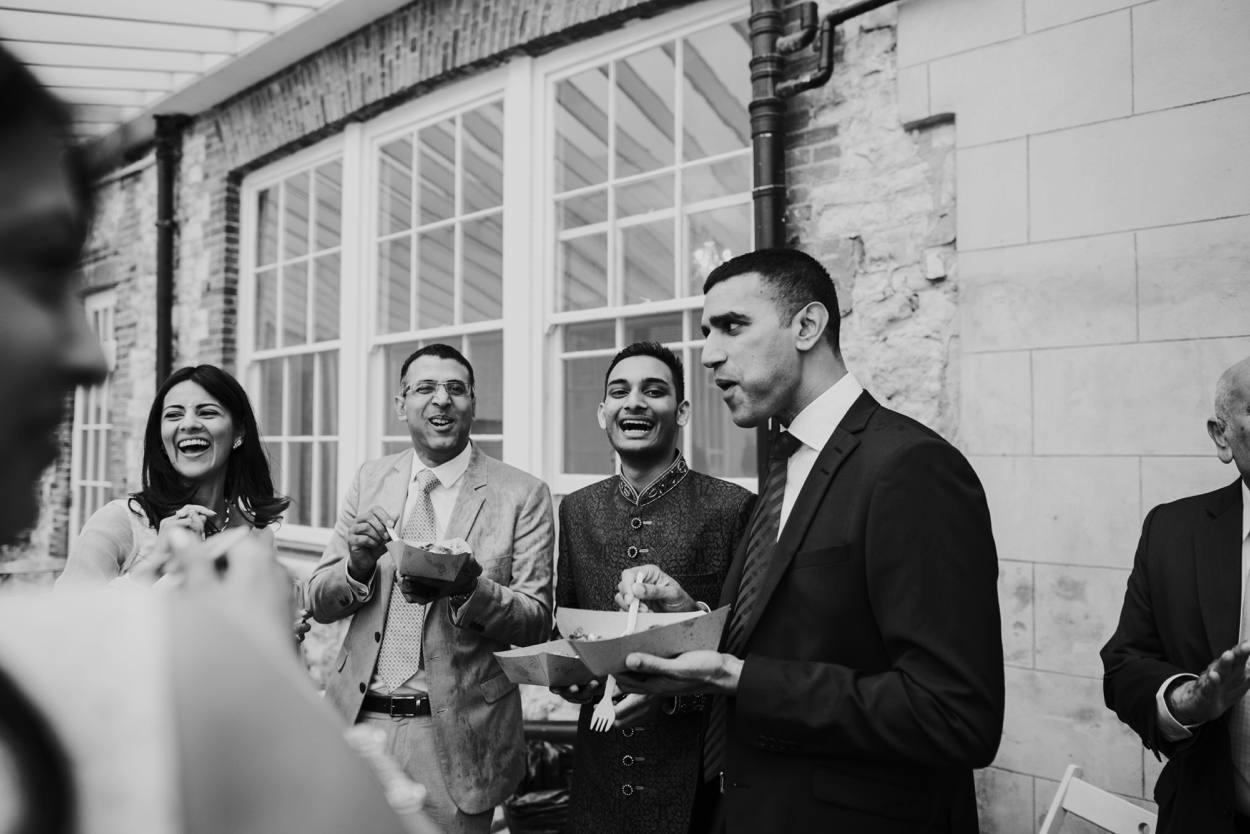 wedding guests enjoying street food at froyle park