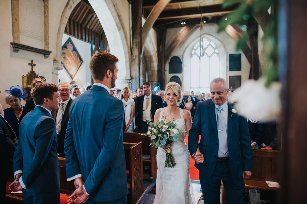 bride walking down the isle in church