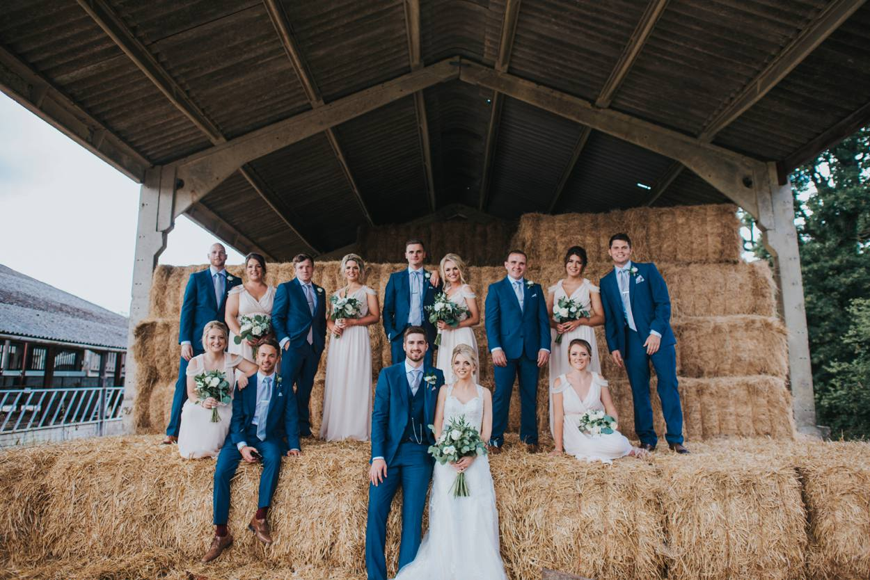 alternative wedding group in hay barn