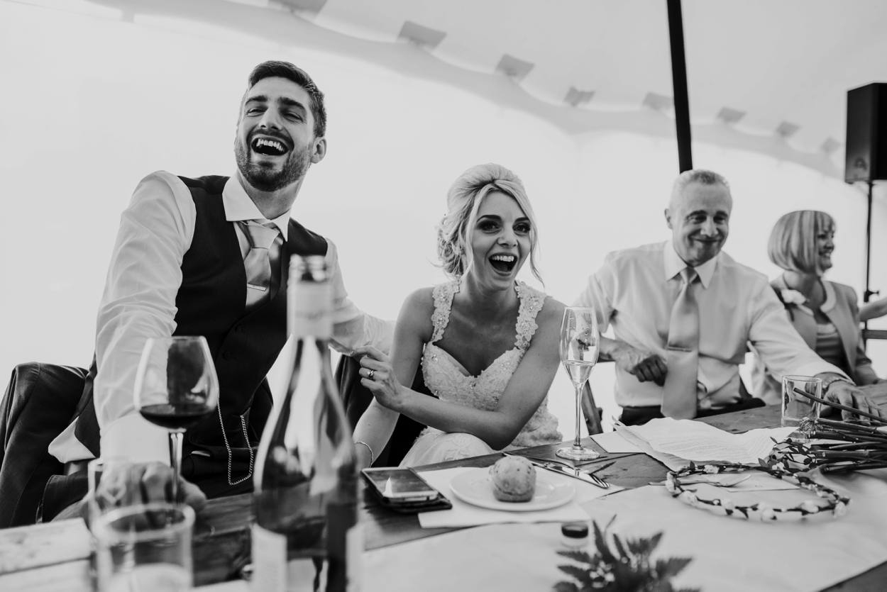 bride and grooms reaction to wedding speech
