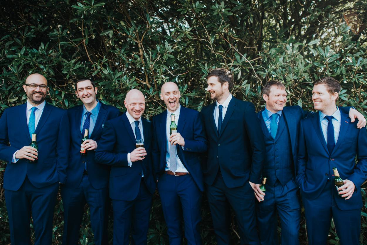 group of guys drinking beer at wedding
