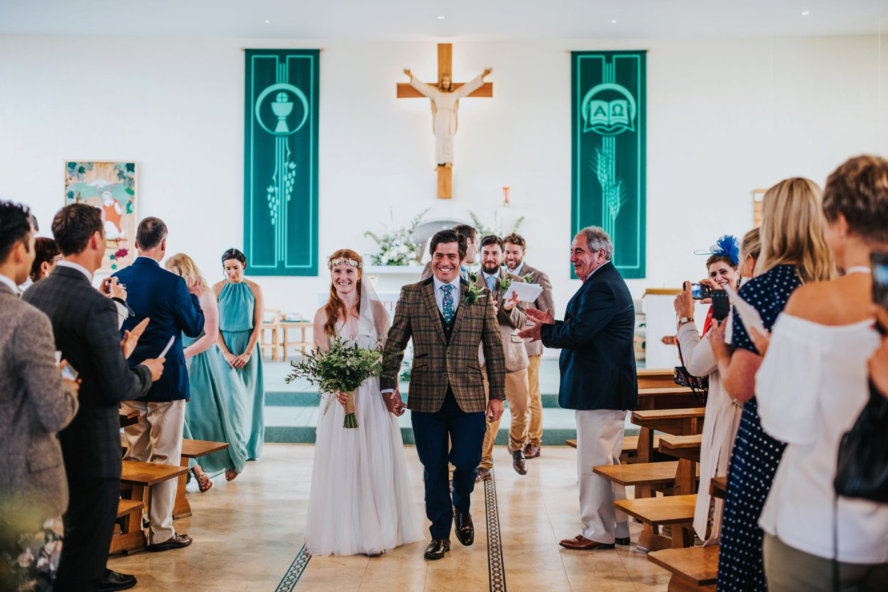 boho bride and groom in tweed suit, just married