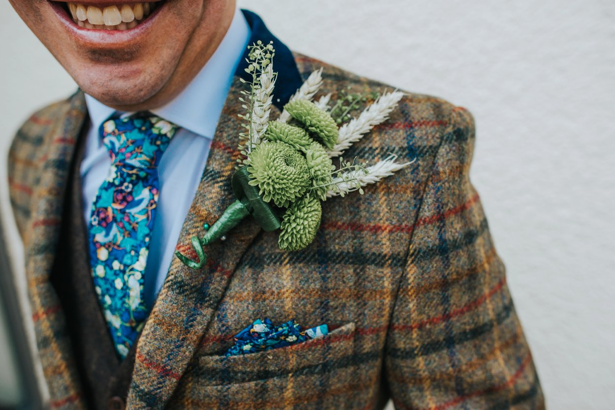 groom in brown tweed suit