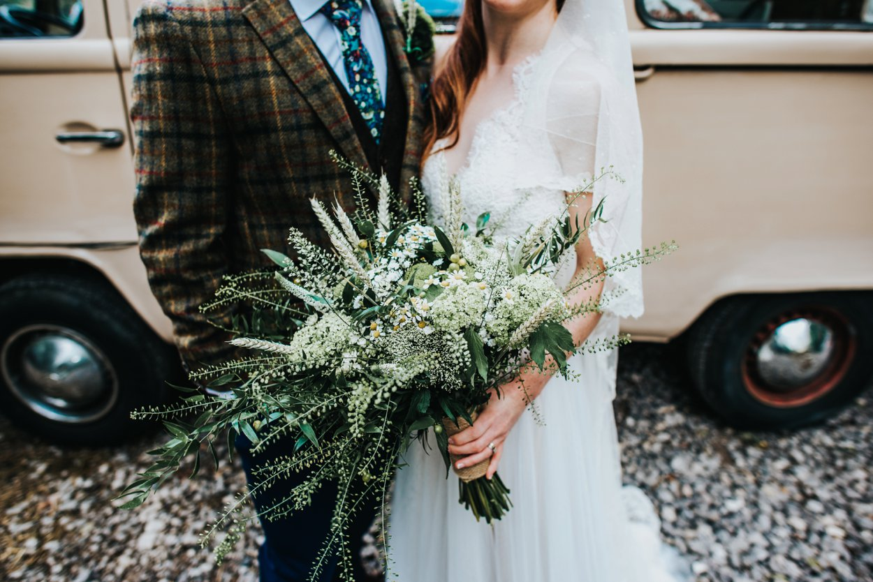 boho bride and groom by VW camper with oversized bouquet