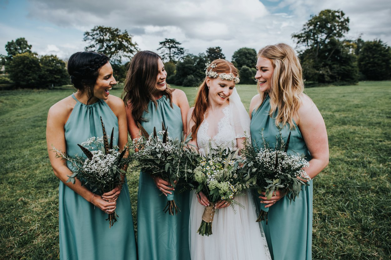 Boho bride and bridesmaids in field