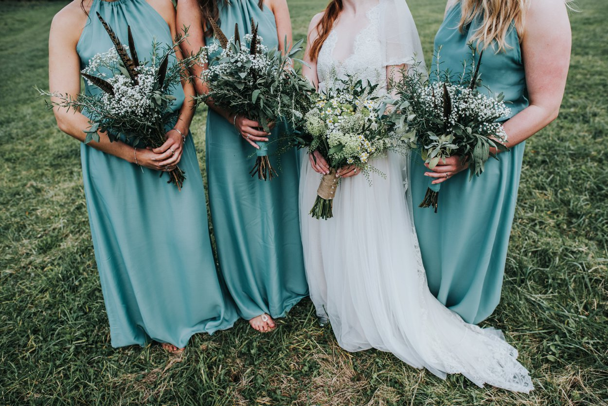 Boho bride and bridesmaids with oversized bouquets