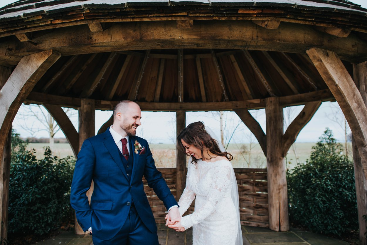 husband and wife laughing on wedding day