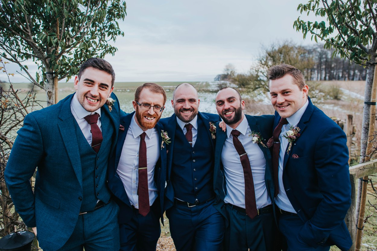 boys in blue suits on wedding day