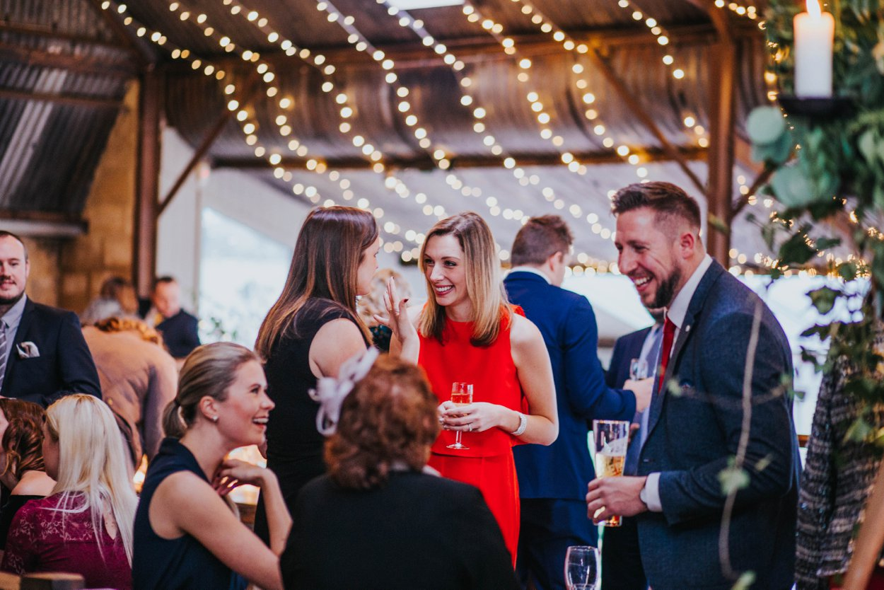 guests laughing at relaxed wedding