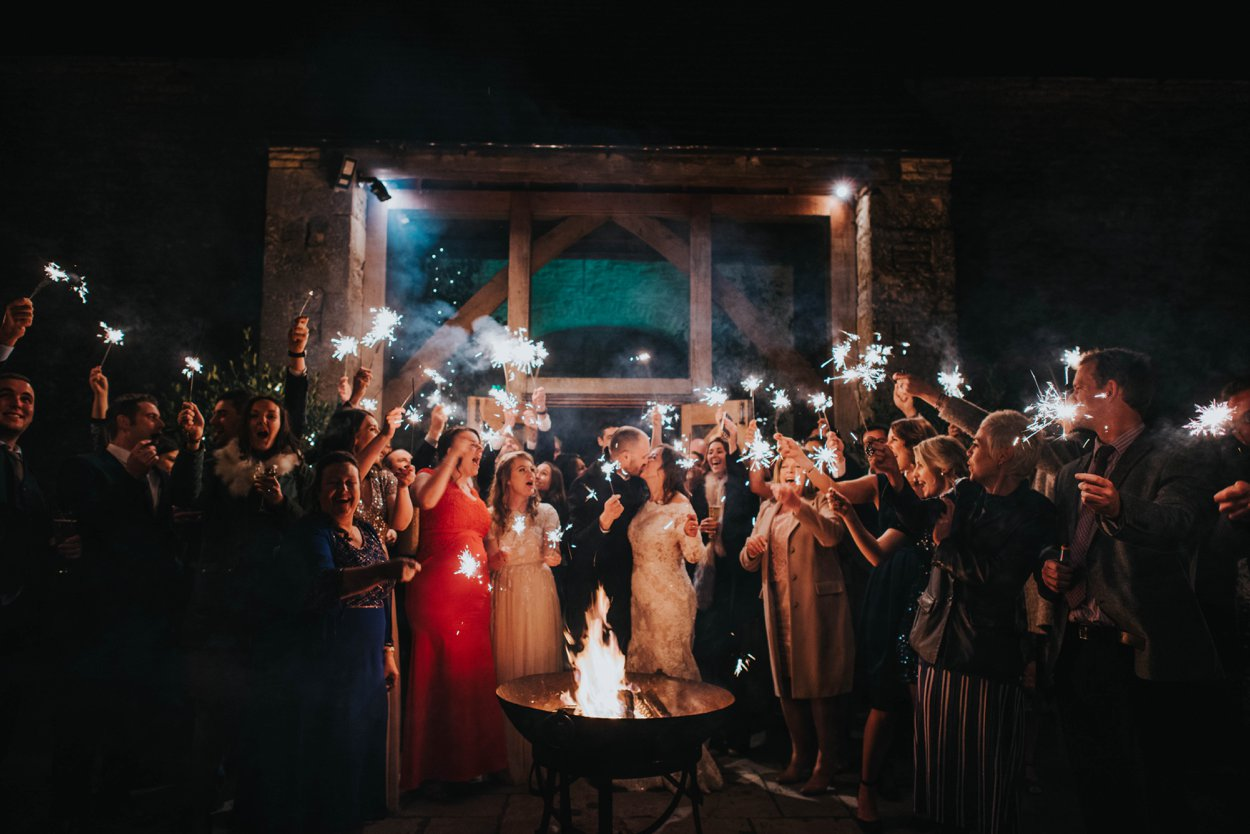 sparkler send off by fire pit at cripps stone barn