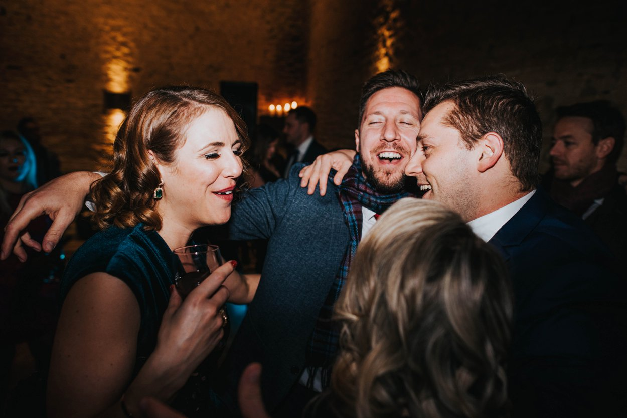 group of friends dancing at wedding