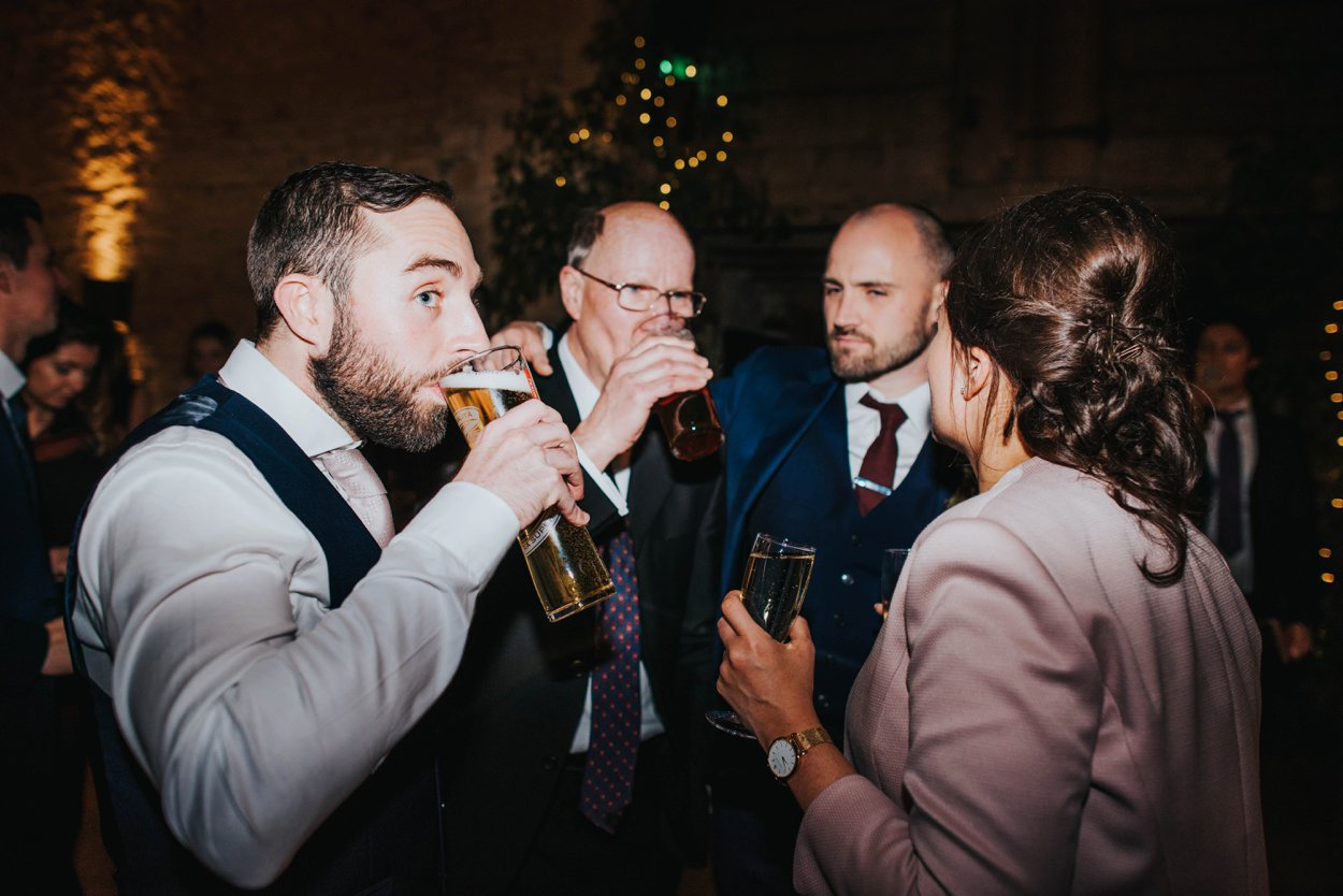 guest drinking at a wedding