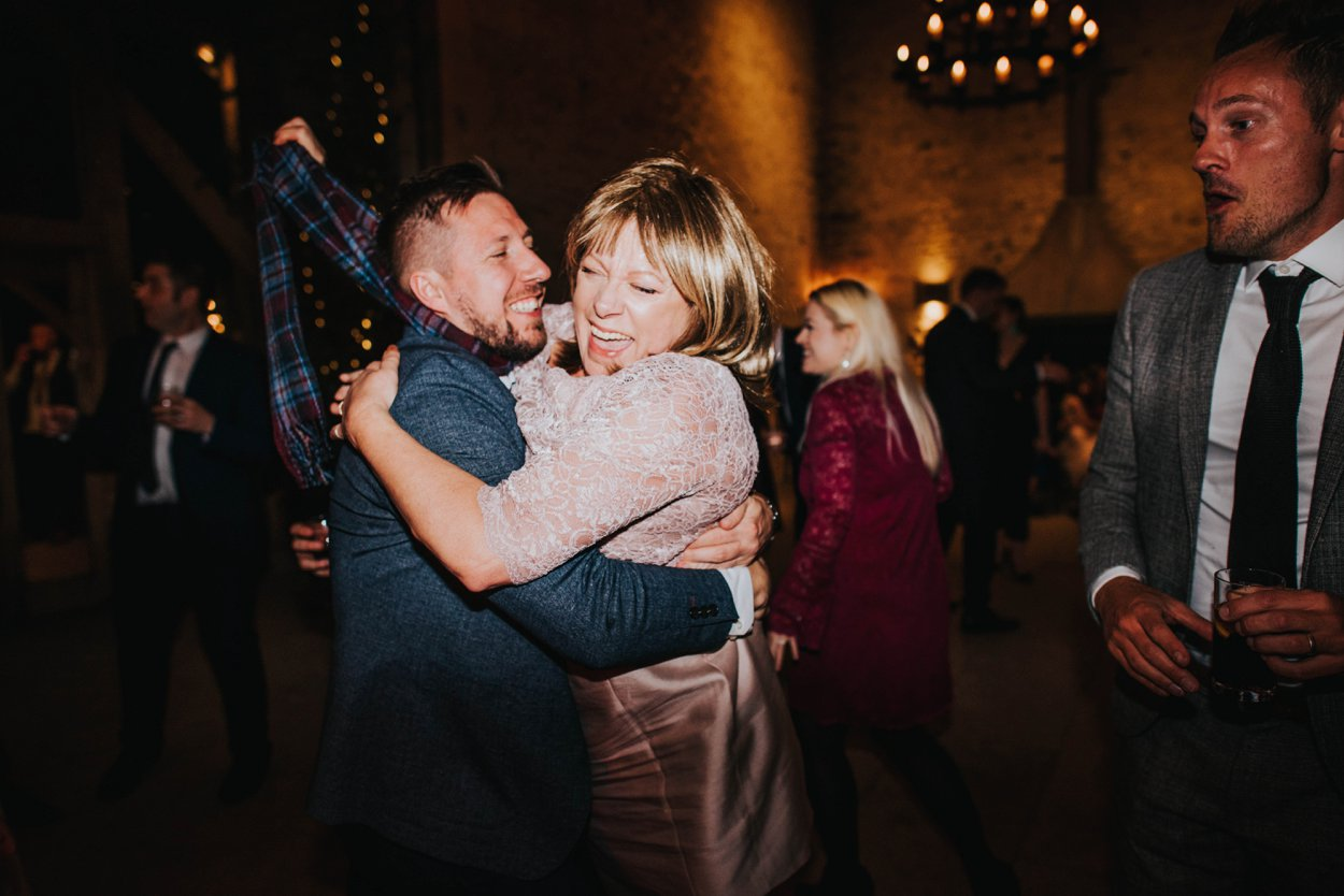 mother of the bride being picked up by guest
